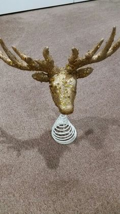 Paid $12 and had the stuff to change the color from white to gold. Due to the fact my theme is Gold/Deer and this was white, I sprayed gold then added these star glitter to it in gold.  It really sparkles when the light hits it.  Also saw one on pinterest that inspired me to add a bow and pic so when my tree turns you don't see the back and looks nicer.