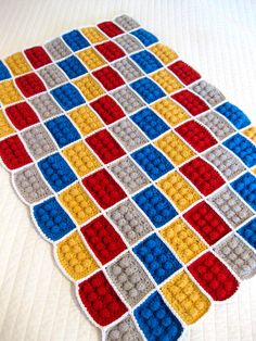 This crocheted LEGO blanket from Andrea at All Things Bright and Beautiful is definitely the coolest design that I've ever seen from a bobble stitch. Wrapping up in a blanket of LEGO goodness=total. Lego Crochet, Knit Or Crochet, Learn To Crochet, Crochet Crafts, Yarn Crafts, Crochet Baby, Free Crochet, Decor Crafts, Bobble Crochet
