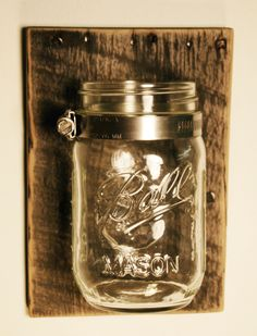Single Mason jar mounted on recycled wood shabby chic rustic wall decor in your choice of color. $12.50, via Etsy.