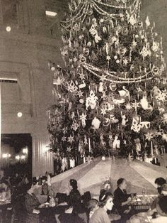 Uncle Mistletoe at the base of the Christmas tree in the Walnut room Marshall Field & Co 1951
