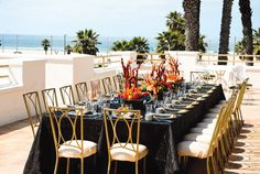 Hunger games inspired thematic Bridal Shower. Beautiful beach view Tablescape.     Simply Sweet Weddings and Events, Orange County