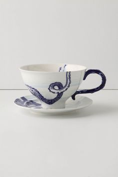 I received this lovely cup for my birthday.  It's delicate and playfully references toile but with tentacles.  The handle is even textured to feel like suckers.  Perfect for a lovely cup of Irish Breakfast tea.