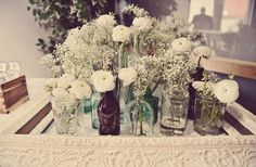 AMBIANCE/DECOR:  using baby's breath with varied bottles (would use fewer at a time for our own settings)