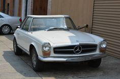 This 1966 Mercedes-Benz 230SL is a original car in need of complete restoration. White with tan interior. It comes with 2 tops and and a 4 speed transmission. For only $14,500  #gullwingmotorcars #classiccars #buy&sellclassiccars #VintageCarBuyer #ClassicCar  #antiqueCarBuyer #1966Mercedes-Benz230sl #Mercedes-Benz