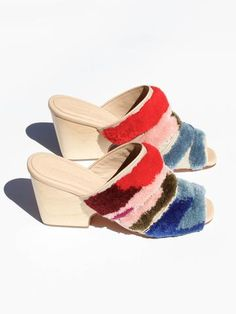 Open toe mule with hand embroidered wool on cotton upper. Leather piping detail. Shaped blonde wood heel. Material- 100% Textile Upper, 100% Leather Sole Made in Peru Heel Height - 70mm
