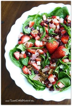 Summer Spinach Strawberry Salad - gorgonzola, bacon, pecans, dried cranberries topped with a sweet balsamic dressing. So darn good.