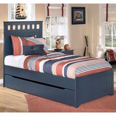 The comfortable cottage design of the Leo Youth Bedroom Collection by Signature Design by Ashley Furniture features a replicated blue paint finish flowing beautifully over the grooved panels and embossed bead framing to make this innovative furniture an inviting addition to any child's bedroom.