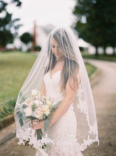 Romantic lace-tipped veil: http://www.stylemepretty.com/georgia-weddings/atlanta/2016/02/22/classic-southern-plantation-wedding-in-georgia/ | Photography: Simply Sarah - http://simplysarah.me/