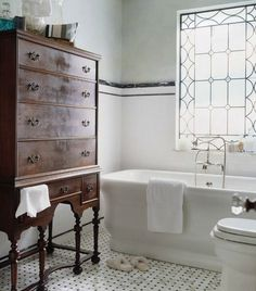 A beautiful antique chest in the bathroom.