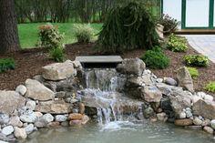 Waterfall in the garden stone water plants garden beautify