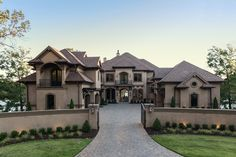 Weber Design Group | Great Curb Appeal in this Stucco Home with a Grand Entrance