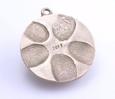 Make a family fingerprint ornament with salt dough + silver spray paint