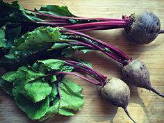 How to cook beets and their greens from your CSA box or fresh from the farmers market! Roasted beets and sauteed beet greens with bacon.
