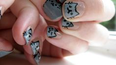 Adorable Pusheen hand-painted nails!    http://handmadenails.tumblr.com/post/25998527245/pusheen-nails-inspired-by