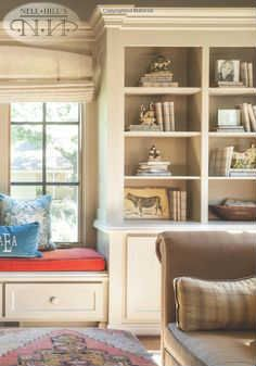Cute window seat #nellhills #inviting #romanshades:  Plain shade or bamboo shade for mud room with pillows in print to match kitchen roman shade?