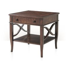 """A mahogany, cerejeira veneered and crossbanded lamp table, the square top above a frieze drawer, on square and splayed legs joined by an undertier and with wavy """"X"""" side stretchers. Inspired by a 19th century French original."""