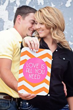 engagement photo idea with a sign