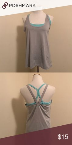 NWOT Strappy Workout tank with built in bra NWOT Strappy Workout tank with built in bra color: aqua and gray Old Navy Tops Tank Tops