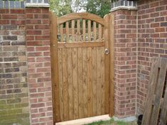In the market for new a wooden gate for your home? Come & have a look at our wooden gate design. Bespoke wooden gates available in timber. T: 01202 670 770 Wood Fence Gates, Wooden Garden Gate, Timber Gates, Brick Fence, Front Yard Fence, Wooden Gates, Garden Fencing, Pallet Fence, Low Fence