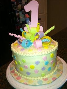 Pastel polka dot first birthday cake