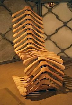 Unique chair...looks like it is made from wooden hangers.