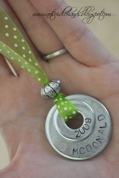 gotta try this cute homemade necklace using washers and metal stampers