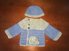 Baby Sweater and hat based on these patterns.   http://www.crochet-patterns-free.com/2013/04/easy-free-crochet-cardigan-for-baby.html?m=1  http://www.repeatcrafterme.com/2014/10/e-is-for-elephant-crochet-elephant.html?m=1  http://www.repeatcrafterme.com/2014/10/e-is-for-elephant-crochet-elephant.html?m=1