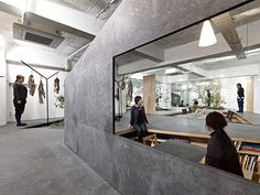 Holes in a wrought iron platform are filled with planted rockeries at this Kobe showroom by Yuko Nagayama & Associates for Japanese fashion brand Sisii. Contemporary Architecture, Contemporary Interior, Kobe, Showroom Design, Interior Design, Narrow Rooms, Fashion Showroom, Workspace Design, Co Working