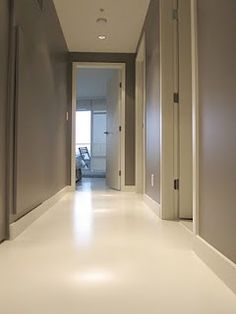 White Cement Floors  Simultaneous contrast:   the contrasting wall and floor colors are affected by each other, neither color reads true in the confined hallway space .    The translucent white Arapido cement softens the dark walls and the floor takes on a warm neutral hue.      Color: white Arapido with low loading of white titanium   Cast-on: clear fine silica aggregates and hardeners  Sealer: Deco Supreme (water-based cross linked urethane and acrylic) plus white pearlesence