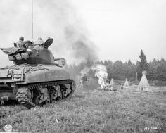 US flamethrower Sherman tank demonstrates its weapon in a field on the border of Germany, Sept 3, 1944.