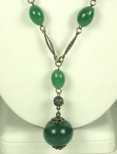 30% off sale until 11/23/15 A silver and green glass necklace. The necklace chain is made up of oval shaped green glass beads that are attached to flattened silver diamond shaped sections as well as a... #dangle #balls #filigree #present #woj #judysgems2 #classic #teamlove