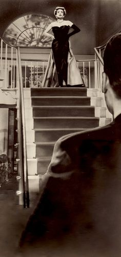 JOAN CRAWFORD in QUEEN BEE 1955 atop her Southern mansion's grand staircase. Eva is a cruel & predatory woman who leaves a trail of broken lives in her wake. The film title is derived from when the cental character is jealous of her position & stings to death all the other females in the hive. (minkshmink collection)
