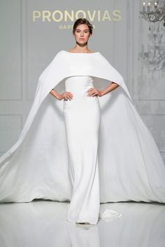 Want to make a real statement walking down the aisle? Then you need this Pronovias cape.
