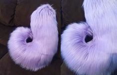 """One custom made-to-order husky tail in your choice of color(s). Husky tails are approx. 16"""" long, 6"""" wide. Both are worn via a sewn-in belt loop, which may not be visible in the picture. They are hand"""