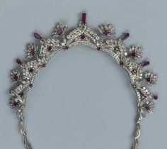 A diamond and amethyst tiara necklace combination. Featuring a series of seven diamond arches, topped with pear-shaped amethysts, with diamond and amethyst floral spacers.
