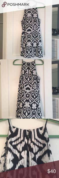 Ikat Shift Dress This high neck, ikat shift can be dressed up or down. The cut is extremely flattering for athletic shoulders and the dress falls around mid-thigh. So cute! Tyche Dresses Mini
