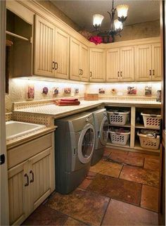 in my dreams. This laundry room provides space for laundry baskets, a counter over the duet washer/dryer, and finishes off the laundry sink. Addition storage cabinets are a welcome addition. Traditional (Victorian, Colonial) Laundry Room by Mari Woods Laundry Room Organization, Laundry Room Design, Laundry Rooms, Small Laundry, Laundry Baskets, Garage Laundry, Laundry Area, Hm Deco, Sweet Home