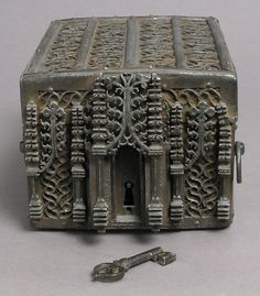 Coffer Date: 15th century Culture: French Medium: Iron on wood core with cloth and leather interior Dimensions: Overall (coffer): 4 3/4 x 6 1/8 x 8 7/16 in. (12 x 15.6 x 21.5 cm) Overall (key): 2 5/16 x 13/16 x 5/16 in. (5.9 x 2.1 x 0.8 cm)