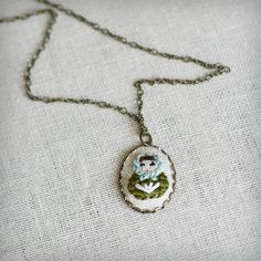 Matryoshka hand embroidered nesting doll necklace. Want this so bad!