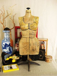 Vintage dress form. notice the shape, how different it is from today's dress forms and mannequins.