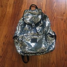 """Vs Sequin Backpack Super cute rare vs sequin backpack in """"meh"""" condition. Used to have 2 holes as pictured. Both have been patched. Other flaws on the bag include fuzzy, pulling drawstring.  All buckles and snaps in place and work properly  Other than patches, bag has no holes  ‼️ Price is firm‼️. Tags: sequins, sequence, Victoria's Secret pink, backpack, campus, bling. PINK Victoria's Secret Bags Backpacks"""