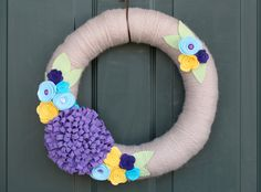 Yarn-wrapped wreath with felt flowers - actual item is Etsy sale, this is simply for inspiration
