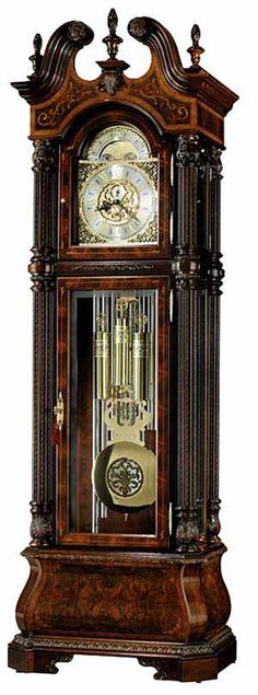 <p> This elegant floor clock, designed by Chris Bergelin features sixteen different species of hardwoods and veneers. These are Cherry, Crotch Figured Mahogany, Russian Walnut Burl, Movingue, Maple, Ebony, Padauk, Silver Gum, Black Cherry, Magnolia, Beech, Avodire, Anegre, Pearwood, English Sycamore, and Boxwood. The beautiful swan neck pediment is crowned wi...