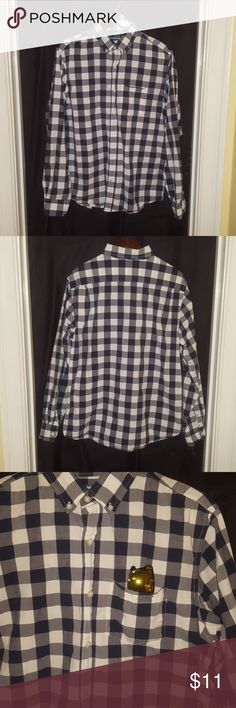 Old Navy regular fit button-up plaid shirt. Old Navy regular fit button-up plaid shirt. Plaid colors consist of black, white, and gray. Very little wear, very good condition. Old Navy Shirts