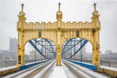 The Smithfield Street Bridge is covered in snow during a storm in Pittsburgh