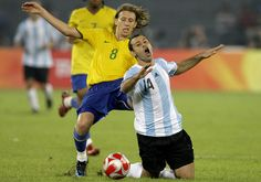 Brazil's Lucas (8) fouls Argentina's Javier Mascherano during their men's semifinal soccer match at the Beijing 2008 Olympics. Lucas received a red card for this foul.