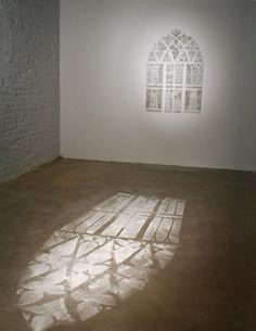Scraped Wall Simulates Light on the Floor with Paint Dust via My Modern Met
