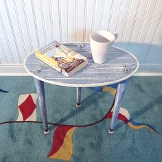 Cottage Porchside Table  3 Legged Beadboard by tablettebyAcey Real cottage beadboard plywood top painted weathered Sun Burst yellow satin finish with a white dock line rope edge surrounding the oval shape, makes a fun and functional porchside companion for supporting your beverage, cellphone, sunscreen, and other summertime items. Visit my shop for more fun products - https://www.etsy.com/shop/tablettebyAcey  #Beach #Cottage #Decor #Furniture #Porch #table #Lakehouse #Accenttable #sidetable