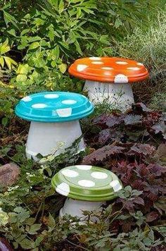 Cute. Made from drip trays and pots