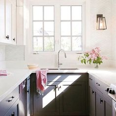 Small u-shape kitchen with white upper cabinets and grey lowers. Pink flowers and accents add elegance and softness. #smallkitchen #ushape #kitchendesign #classic
